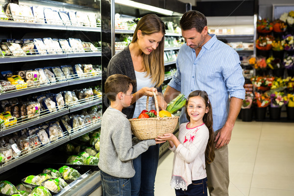 Cute family doing grocery shopping together Stock photo © wavebreak_media