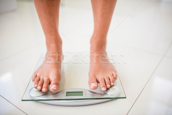 Feet of woman on weighting scale Stock photo © wavebreak_media