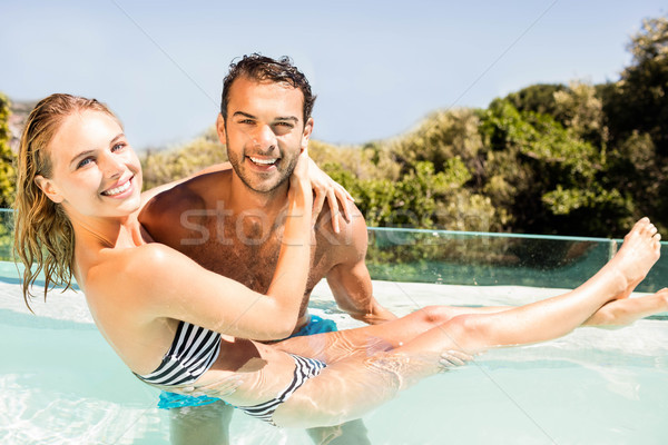 Bell'uomo fidanzata piscina donna amore Foto d'archivio © wavebreak_media