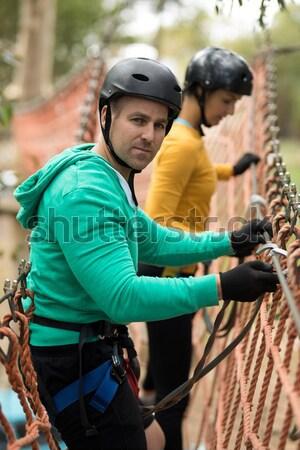 Friends walking on rope bridge Stock photo © wavebreak_media