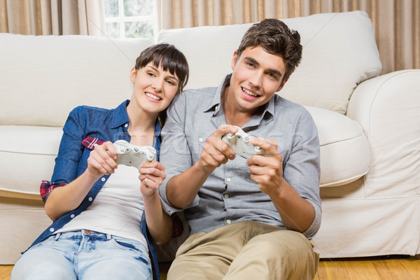 Couple playing video game Stock photo © wavebreak_media