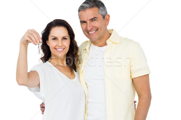 Portrait of happy couple holding home keys Stock photo © wavebreak_media