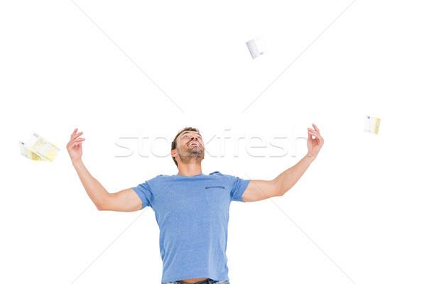 Fiatalember dob valuta jegyzetek izgalom fehér Stock fotó © wavebreak_media