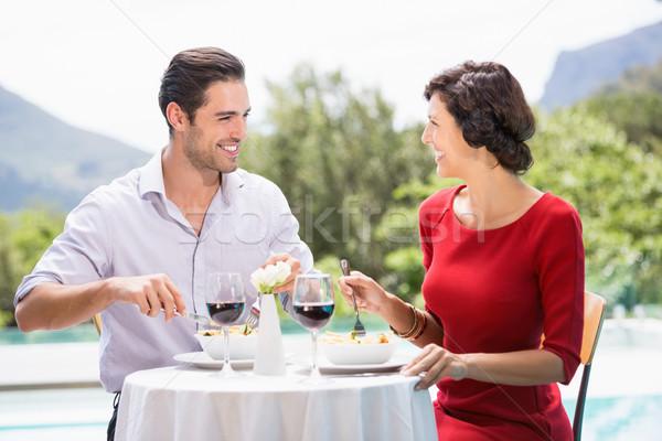 Happy couple having food  Stock photo © wavebreak_media