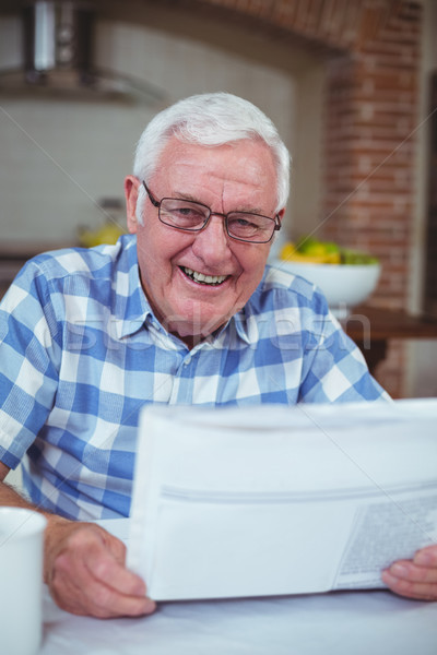 Stock photo: Happy senior man with newspaper