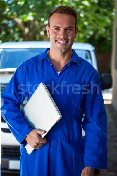 Portrait of mechanic holding a laptop Stock photo © wavebreak_media