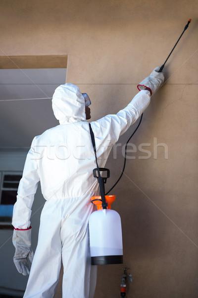 Rear view of a man doing pest control Stock photo © wavebreak_media