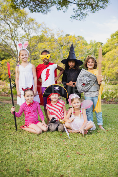 Children with fancy dress smiling and posing together Stock photo © wavebreak_media