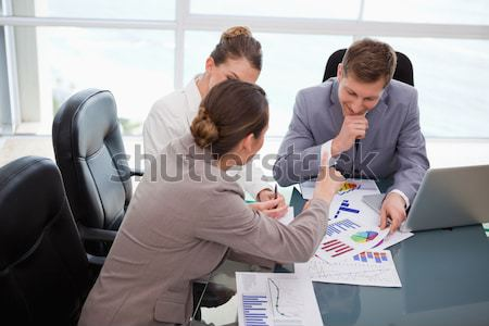 Side view of two business people looking at post it wall Stock photo © wavebreak_media