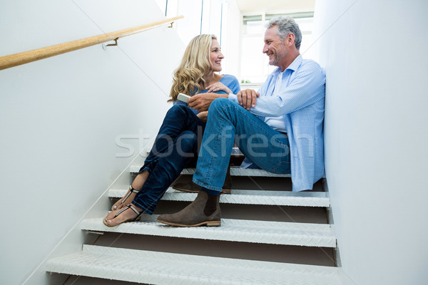 Smiling couple sitting on steps Stock photo © wavebreak_media