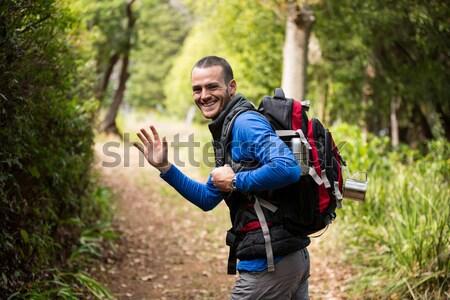 Male hiker looking through binoculars Stock photo © wavebreak_media