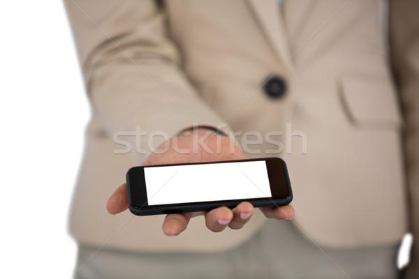Középső rész üzletasszony tart mobiltelefon fehér nő Stock fotó © wavebreak_media