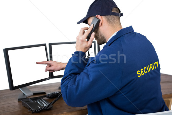 безопасности офицер говорить телефон указывая компьютер Сток-фото © wavebreak_media