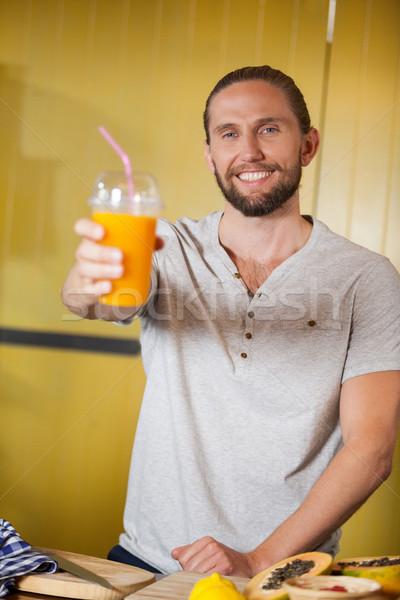 Stock fotó: Férfi · személyzet · tart · narancslé · üveg · organikus