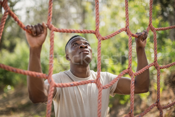 Military soldier climbing net during obstacle course Stock photo © wavebreak_media