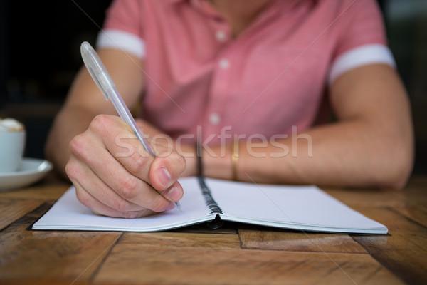 Man schrijven dagboek tabel coffeeshop vlees Stockfoto © wavebreak_media