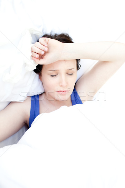 Sick teen girl lying in her bed Stock photo © wavebreak_media
