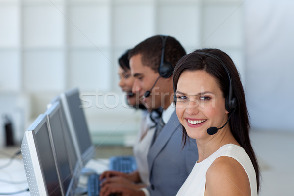 Smiling businesswoman in a call canter  Stock photo © wavebreak_media
