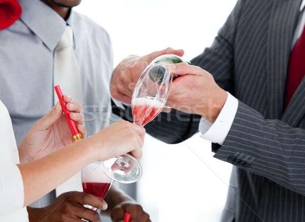 Közelkép kettő kolléga iszik pezsgő ünnepel Stock fotó © wavebreak_media