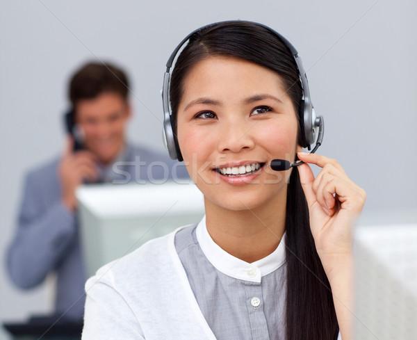 Asiático empresária fone secretária escritório negócio Foto stock © wavebreak_media