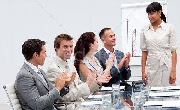 Businessman applauding a colleague after giving a presentation Stock photo © wavebreak_media