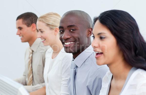 Ethnic businessman and his team at work Stock photo © wavebreak_media