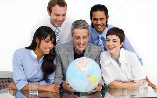 Diversidade olhando globo escritório Foto stock © wavebreak_media