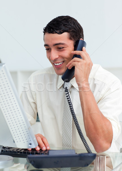 Stock photo: Smiling businessman talking on phone