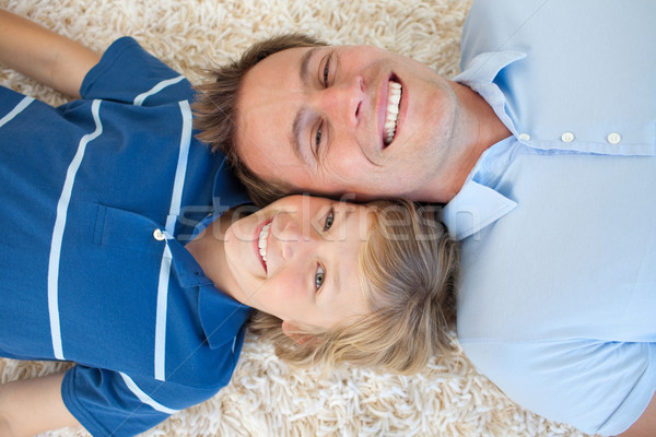 Animated father and his son lying on the floor  Stock photo © wavebreak_media
