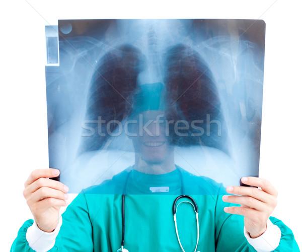 Sorridente cirurgião olhando raio x escritório branco Foto stock © wavebreak_media