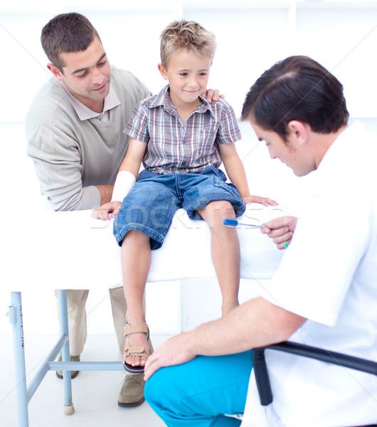 Doctor checking a patient reflexes Stock photo © wavebreak_media
