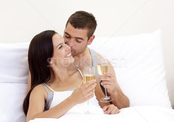 Lovers drinking champagne in bed Stock photo © wavebreak_media