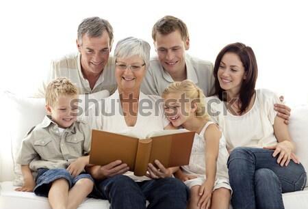 Nonna lettura libro bambini genitori soggiorno Foto d'archivio © wavebreak_media