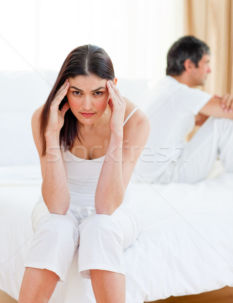Sad couple sitting sitting separately on their bed after having a row  Stock photo © wavebreak_media