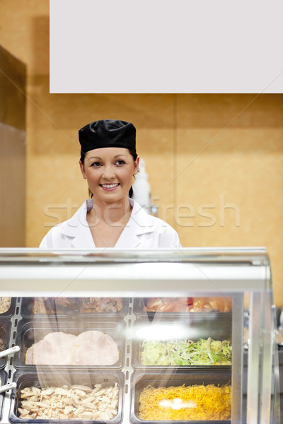 Portrait of a cute baker smiling at a customer in a  cafeteria Stock photo © wavebreak_media