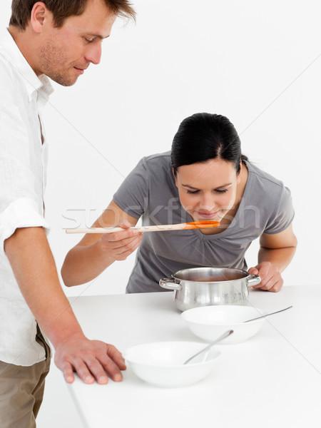 Cute kobieta zupa mąż kuchnia Zdjęcia stock © wavebreak_media