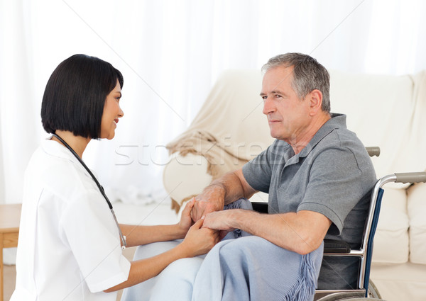 Hombre silla de ruedas enfermera casa mujer médico Foto stock © wavebreak_media