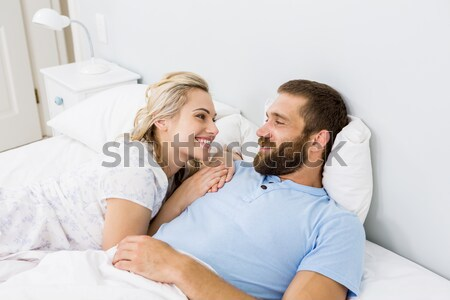 Pretty woman hugging her husband on their bed at home Stock photo © wavebreak_media