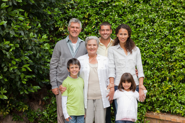 Portrait of a happy family looking at the camera in the garden Stock photo © wavebreak_media