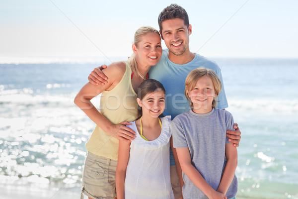 Radosny rodziny plaży wody kobiet piasku Zdjęcia stock © wavebreak_media