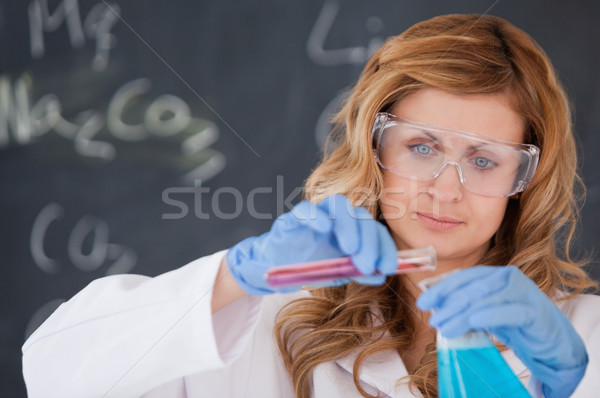 Young female scientist carrying out an experiment in a laboratory Stock photo © wavebreak_media