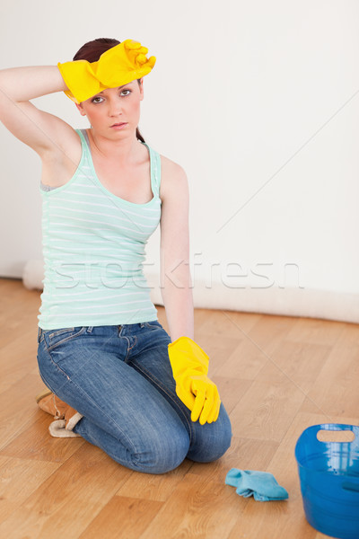 Good looking red-haired woman having a break while cleaning the floor at home Stock photo © wavebreak_media