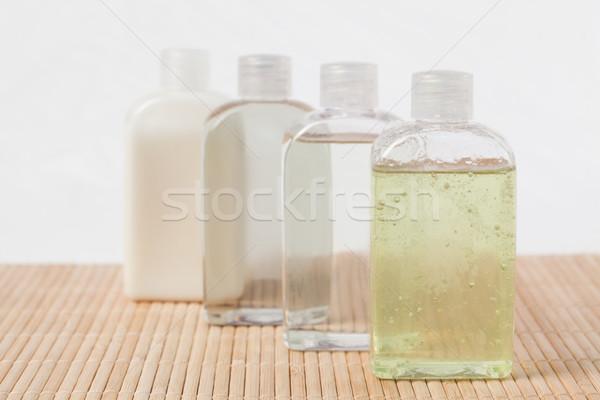 Masszázsolaj üvegek virág víz textúra absztrakt Stock fotó © wavebreak_media