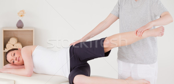 Sportswoman having a leg and hips stretching Stock photo © wavebreak_media