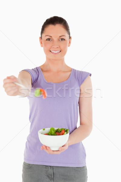 Mulher atraente tigela salada em pé branco Foto stock © wavebreak_media