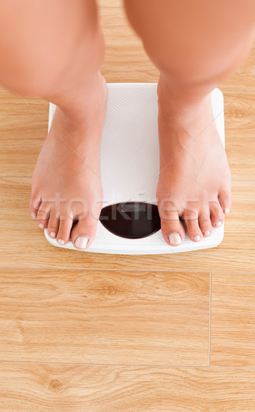 Portrait of feminine legs on a weighing machine Stock photo © wavebreak_media