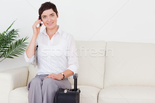 Bájos nő telefonál bőrönd váróterem telefon boldog Stock fotó © wavebreak_media