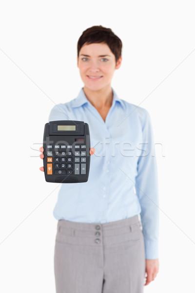 Kadın ofis çalışanı hesap makinesi beyaz iş Stok fotoğraf © wavebreak_media