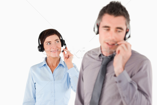 Business people speaking through headsets against a white background Stock photo © wavebreak_media