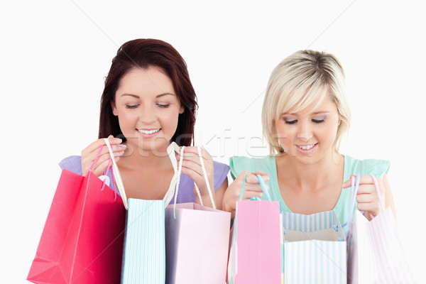 Happy young women with shopping bags in a studio Stock photo © wavebreak_media